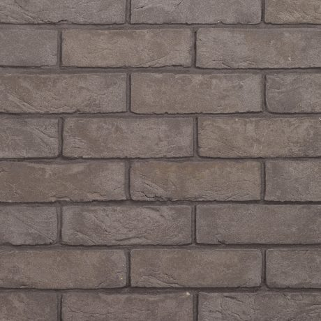 Packshot of a panel with Agora Titaangrijs facing bricks