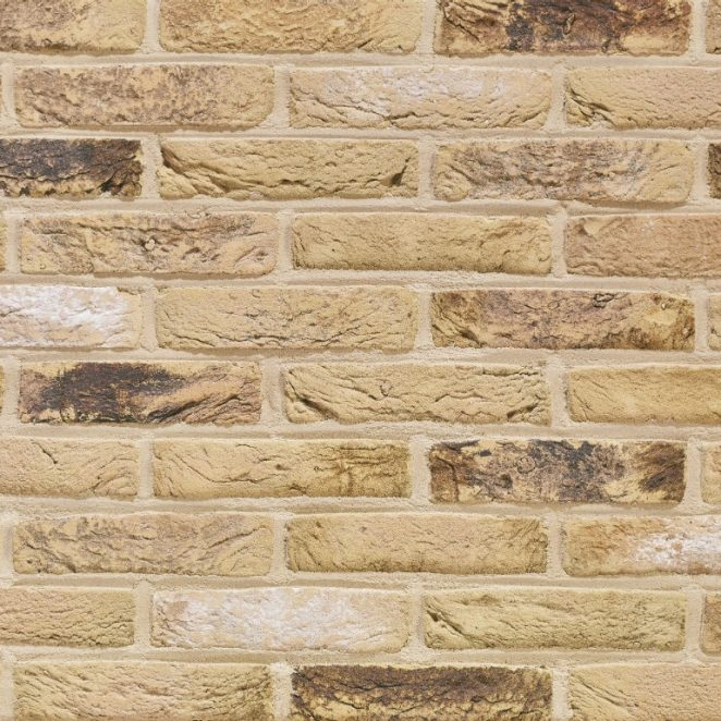 Arces Corn Geel facing bricks in a running bond with traditional mortar application and a beige joint